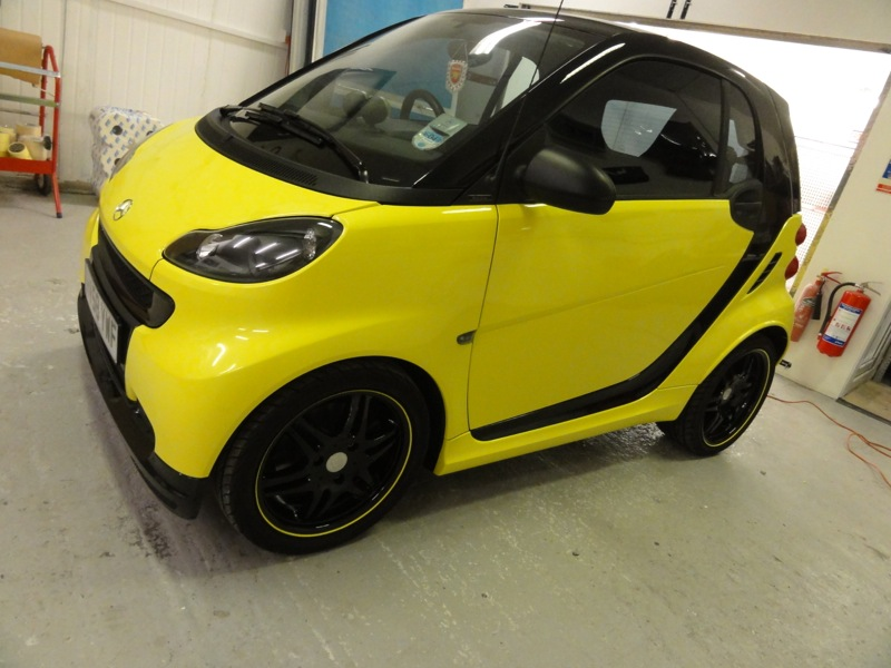 Black and Yellow Smart after Alloy Black Wheels and Vinyl Wrap